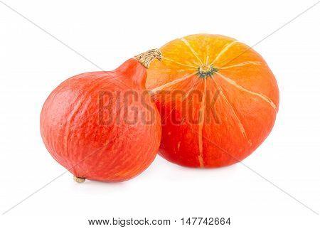 Two pumpkin Hokkaido squash isolated on white