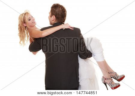 Wedding day. Portrait of happy couple groom carrying bride in his arms on white background