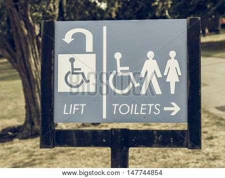 Vintage Looking Lift And Toilets Sign