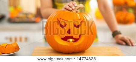 Closeup On Big Pumpkin Jack-o-lantern With Candle Inside