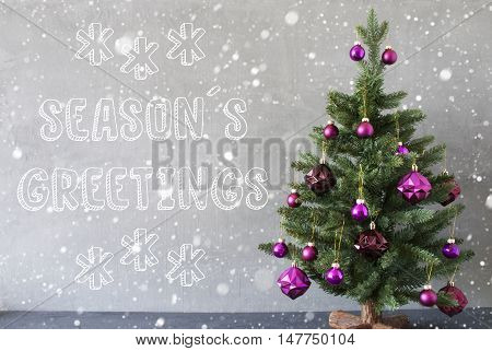 Christmas Tree With Purple Christmas Tree Balls And Snowflakes. Card For Seasons Greetings. Gray Cement Or Concrete Wall For Urban, Modern Industrial Styl. English Text Seasons Greetings