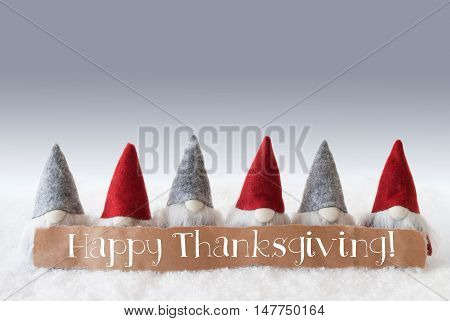 Label With English Text Happy Thanksgiving. Christmas Greeting Card With Gnomes. Silver Background With Snow.