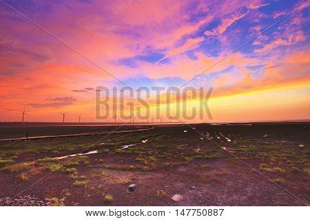 Wetlands against the blue sky with orange clouds,fiery orange sunset sky,beautiful sky.