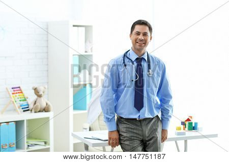 Pediatrician at his office