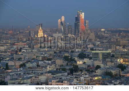 Residential buildings, roofs and skyscrapers at summer morning in Moscow, Russia