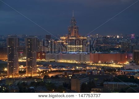 Residential buildings, skyscrapers and roofs at summer night in Moscow, Russia