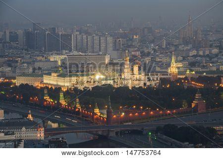 Illuminated Kremlin towers, Ivan Great belltower, bridge in center of Moscow, Russia at night