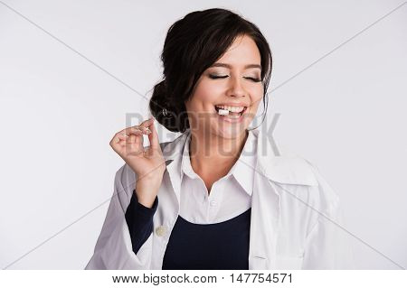 Young woman with a tablet in the mouth