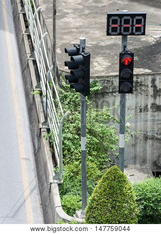 Tarffic light pole with digital display in the intersection of uban area.