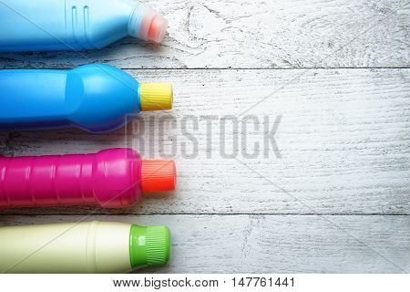 House cleaning products on wood table, top view