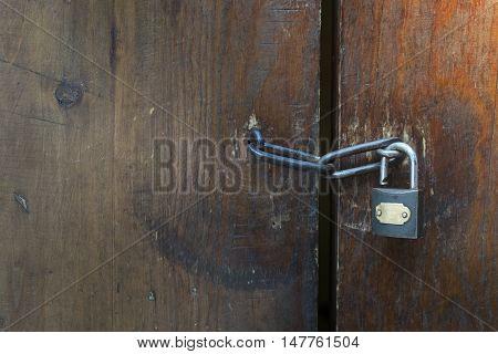 close up of locked old wooden door