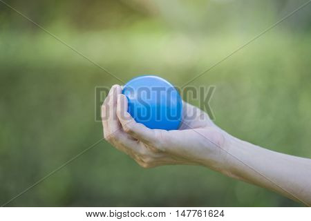 Hand of a woman squeezing a stress ball