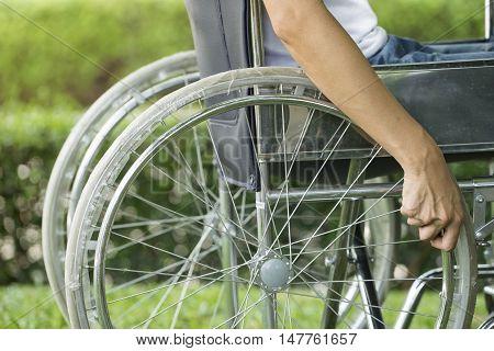 woman using a wheelchair in a park
