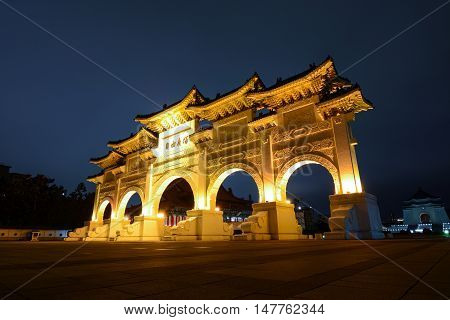 TAIPEI, TAIWAN - SEPTEMBER 8, 2016 - Liberty Square Gate of Integrity at night in front of Chiang Kai-shek Memorial Hall in Taipei, Taiwan. The Chinese text says: