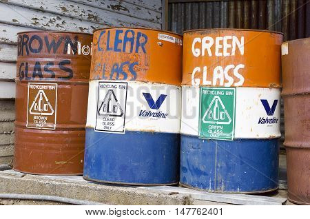 Magra, Australia-March 10 2004. Large industrial bins labelled for glass bottle recycling Magra, Tasmania