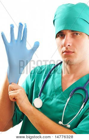Doctor pulling on surgical glove