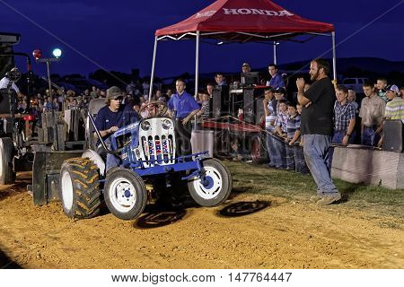 MYERSTOWN, PENNSYLVANIA - SEPTEMBER 16, 2016: A young man drives a modified lawn tractor at Myerstown East End Days. The tractor pull is an annual community event.