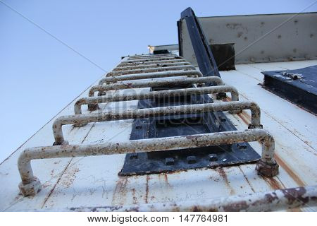 Looking up at a ladder at the Frankfort Lighthouse, Michigan