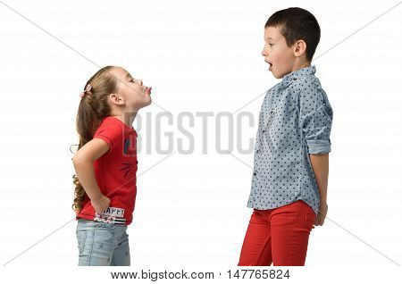 relationship between the children. Girl teasing and showing tongue