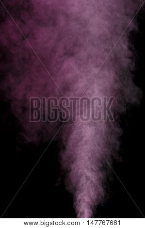 Abstract purple water vapor on a black background. Texture. Design elements. Abstract art. Steam the humidifier. Macro shot.