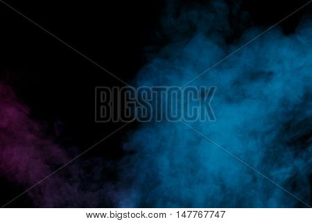 Abstract purple blue water vapor on a black background. Texture. Design elements. Abstract art. Steam the humidifier. Macro shot.