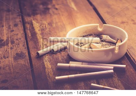 cigarette with ashtray on wood table. cigarette