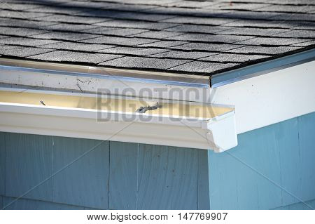 close up on gutter and new installed roof