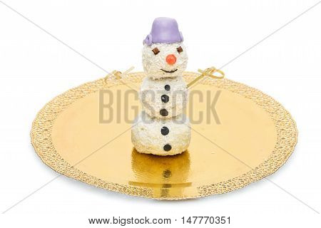 Sweet pops dessert with coconut made in shape of snowman on golden plate. Isolated over white background. Copy space.