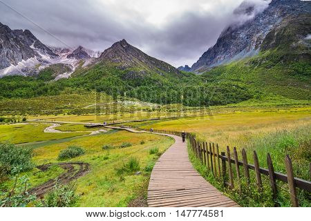 beautiful lake and wooden walkway in Yading, Sichuan, China