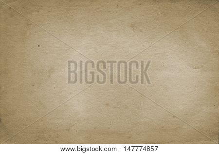 Yellowed old paper background. Natural old paper texture for the design.