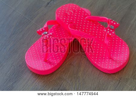 rubber slippers on wooden background