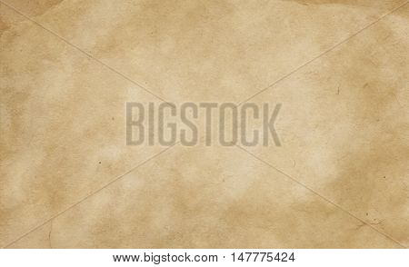 Aged and yellowed paper background. Natural old paper texture for the design.