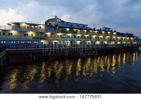 PLES RUSSIA - JULY 20 2016: Unidentified people are relaxing on decks of cruise ship