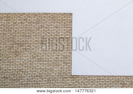 Modern brick wall fragment with white painted plaster background. Copy space for text or image