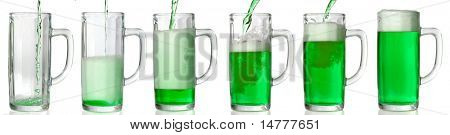 Green Beer mug isolated on white. Pouring green beer in it. 43 Mpxls.