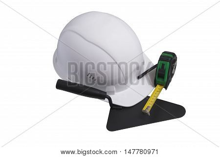 Construction protective helmet and trowel isolated completely white background.