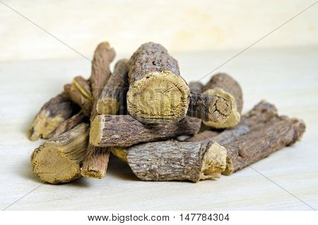 Licorice Or Liquorice Root Sticks Isolated On Wood Background