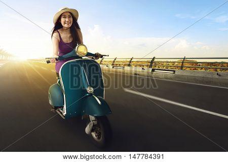 Young Asian Women Enjoy Riding A Scooter And Having Fun