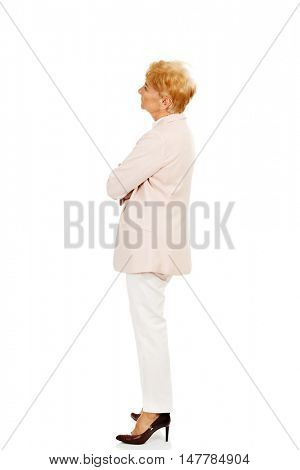 Worried elderly business woman with arms folded