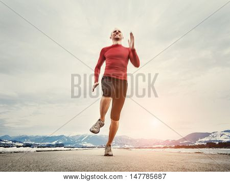 Last runners steps before finish line .