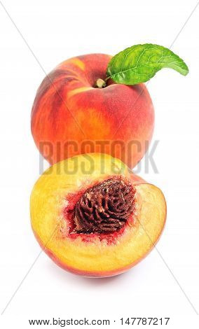 Peach with leaves on a white background