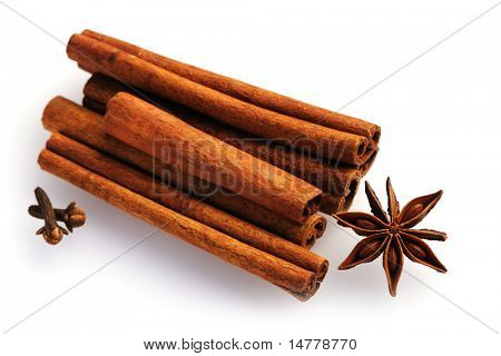 Cinnamon sticks and anise over white background