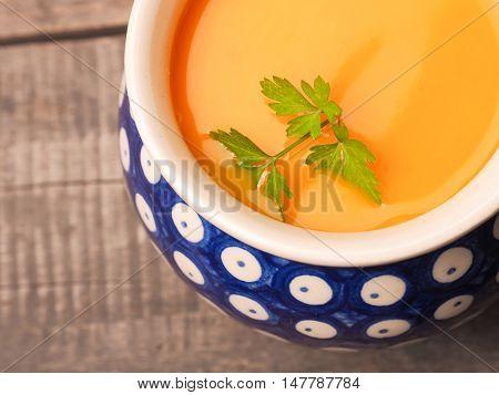 Hokkaido pumpkin cream soup close up shot