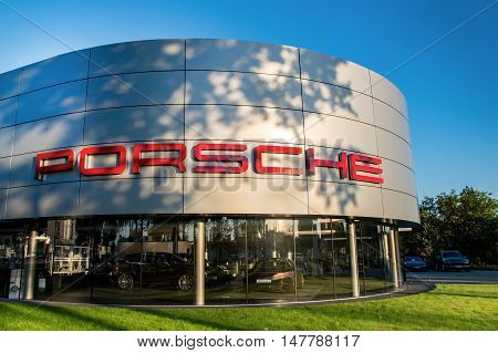 WROCLAW POLAND- SEPTEMBER 17th 2016: Building of polish Porsche dealer in Wroclaw. Porsche is a German automobile manufacturer specializing in high-performance sports cars SUVs and sedans.