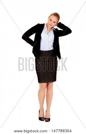 Business woman having huge neck pain