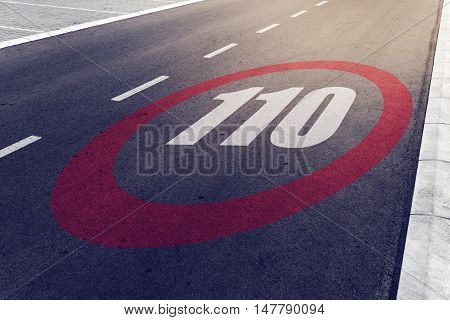 110 kmph or mph driving speed limit sign on highway road safety and preventing traffic accident concept.