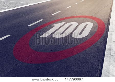 100 kmph or mph driving speed limit sign on highway road safety and preventing traffic accident concept.