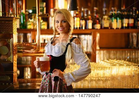 Smiling young woman in a pub