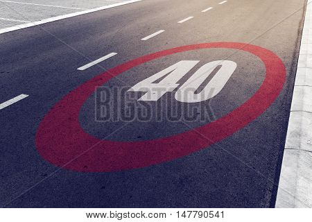 40 kmph or mph driving speed limit sign on highway road safety and preventing traffic accident concept.