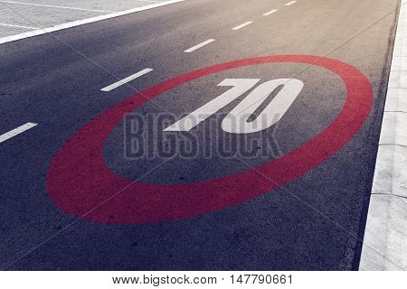 70 kmph or mph driving speed limit sign on highway road safety and preventing traffic accident concept.
